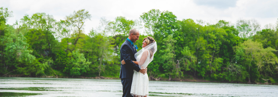 Bridge and groom embrace on a dock