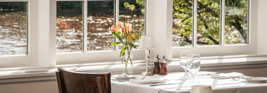 A river view table at The Golden Pheasant, a Bridgeton House guest favorite.