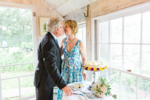 elopement couple kissing in tea house at Bridgeton House