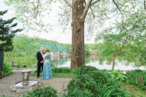 Elope in PA. Bride and groom exchanging vows on the river bank