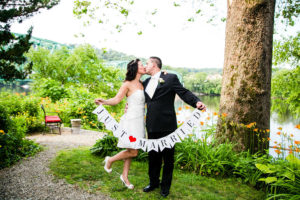 Just married couple kissing by the river