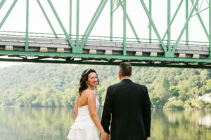 Elopement packages 90 minutes from NYC - wedding couple holding hands on dock