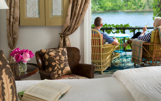couple enjoying the view from their screened riverview porch - New Hope getaway