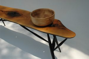 Hand carved bowl and bench at River's Edge Gallery