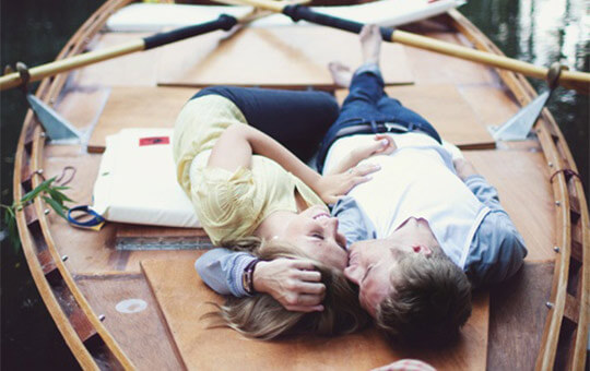 couple relaxing on boat deck