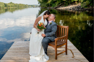 wedding couple with very happy smiles on the dock, Bucks county's only riverfront inn