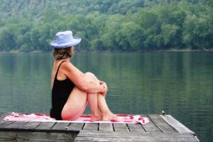 Swimmer relaxing on the Dock at the Bridgeton House in Summer