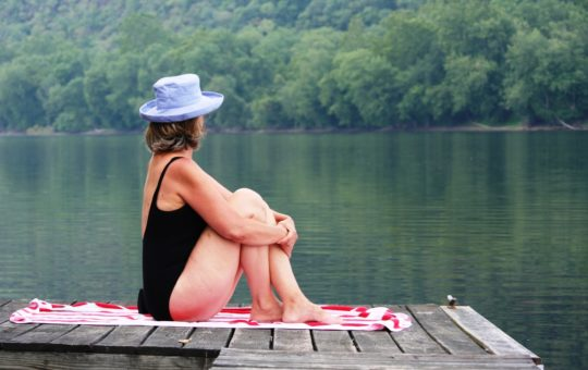 Swimmer relaxing on the Dock at the Bridgeton House in Summer in Bucks County PA