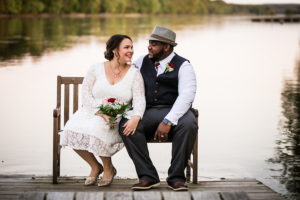 wedding couple gaze on dock bench