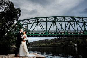 Wedding Couple on Dock with Clouds
