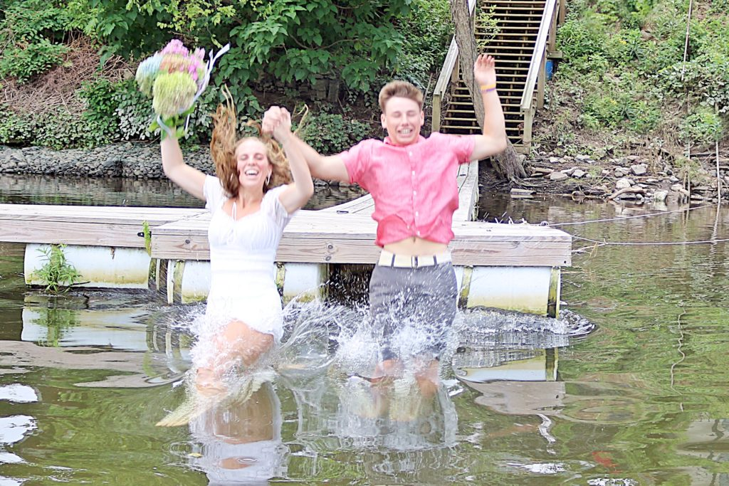 Wedding Couple Jumping Into River
